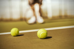 Tennis balls on court Stock Image