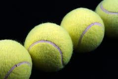Tennis balls, diagonal view. Tennis balls over black background Stock Photo