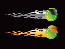 Tennis balls with flames. Tennis balls with silver and orange flames Royalty Free Stock Image