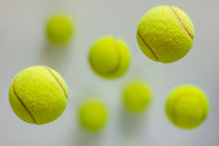 Tennis balls. Flying tennis balls on gray background Stock Images