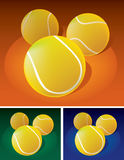 Tennis balls on ground. 3 color versions, grass, clay and hard surface Royalty Free Stock Images