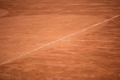 Tennis balls on the ground of clay court Stock Images