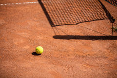 Tennis balls on the ground of clay court Stock Image