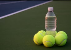 Tennis Balls grouped with water bottle Royalty Free Stock Images
