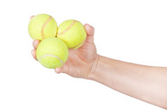 Tennis balls in hand. Royalty Free Stock Images