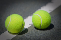 Tennis Balls on Har-Tru clay tennis court Royalty Free Stock Images