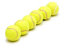 Tennis balls isolated. On the white background Stock Photos