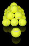 Tennis balls isolated on black Stock Photos