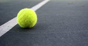 Tennis balls lying in the court. Tennis balls lying on the center line of the court 4k stock video