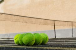 Tennis balls lying on the field. stock image