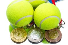 Tennis balls and medals stock images