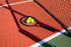Tennis Balls & racket. Under net's shadow Stock Images