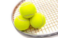 Tennis balls on racket Stock Images