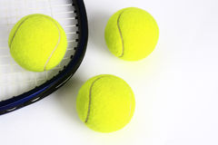 Tennis balls and racket. On a white background Stock Photography