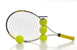 Tennis Balls and Racket. New tennis ball and a tennis racket on white background with copy space Royalty Free Stock Images