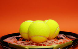 Tennis balls with racket Royalty Free Stock Photography