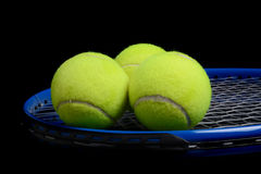 Tennis Balls and Racket Royalty Free Stock Photography