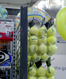 Tennis balls and racket strong in the mall Stock Photos