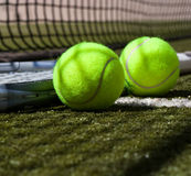 Tennis balls and racquet Royalty Free Stock Photography