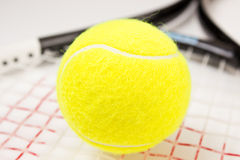 Tennis balls and racquet Stock Photography