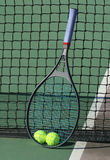 Tennis Balls/Racquet at Net Royalty Free Stock Images