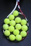 Tennis Balls on Racquet Strings Stock Photo