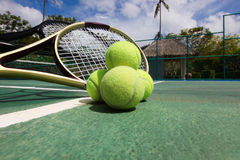 Tennis balls and racquets on court. Tennis balls and racquets on the court close-up Royalty Free Stock Photo