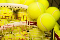 Tennis balls and racquets. Royalty Free Stock Photo