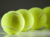 Tennis balls in the row royalty free stock photography
