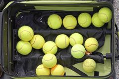 Tennis balls. Several used green tennis balls in suitcase royalty free stock image