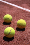 Tennis balls on slag field Royalty Free Stock Photo