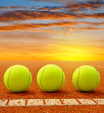 Tennis balls on a tennis clay court Royalty Free Stock Image