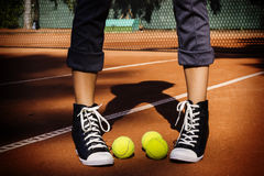 Tennis balls on a tennis court. Tennis balls on the tennis court are close to the person Stock Photography