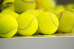 Tennis balls on a tennis court. Individual sport.  royalty free stock photography