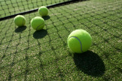 Tennis balls on tennis grass court. Royalty Free Stock Image