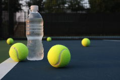 Tennis Balls and water Stock Image