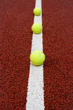 Tennis balls. On a white line Royalty Free Stock Photography