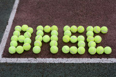 Tennis Baseline. Created using tennis balls on a hard court surface Stock Photo