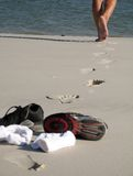 Tennis on the beach. Legs walking and socks and tennis on the beach Royalty Free Stock Photography
