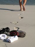 Tennis on the beach. Legs walking and socks and tennis on the beach Stock Photo