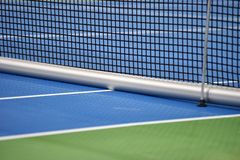 Tennis blue hard court with net Royalty Free Stock Image