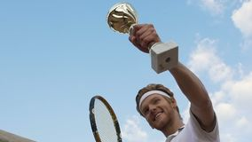 Tennis champion with prize in hand feeling happy after match, award ceremony