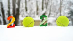 Free Tennis Christmas And 2020 New Year Concept With Tennis Balls And Candles With Numbers On White Snow, Isolated Royalty Free Stock Images - 152934629