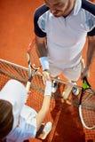 Tennis coach congratulate to young player Royalty Free Stock Photos