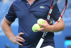 Tennis coach holding US Open Wilson tennis balls at Billie Jean King National Tennis Center Royalty Free Stock Images