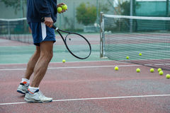 Tennis coach outdoors Royalty Free Stock Photography