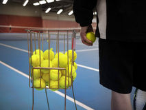 Tennis Coach. Photo of a Tennis Coach holding a ball Stock Images