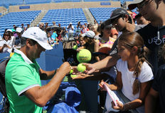 Tennis coach Tony Nadal of Spain signing autographs after practice with Grand Slam champion Rafael Nadal for US Open 2016 Stock Photos