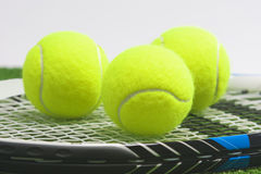 Tennis concept: extreme closeup, tennis racket with balls lies o Stock Photography