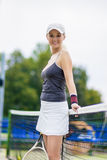 Tennis Concept: Portrait of Positive Smiling Professional Female Royalty Free Stock Image